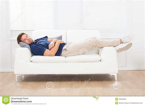 man sleeping on couch man sleeping on sofa at home stock photo image 46359584