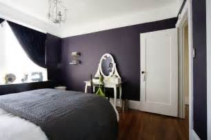 dark purple wall color with vintage white vanity table and