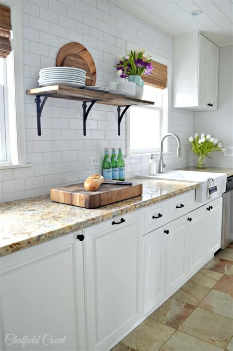 10 sparkling kitchens with open shelving farmhouse kitchen open shelving choices the happy housie