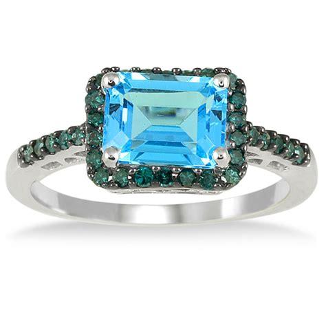 2 50 carat emerald cut blue topaz and blue ring in