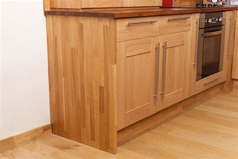 installing cabinet end panels in solid oak kitchens