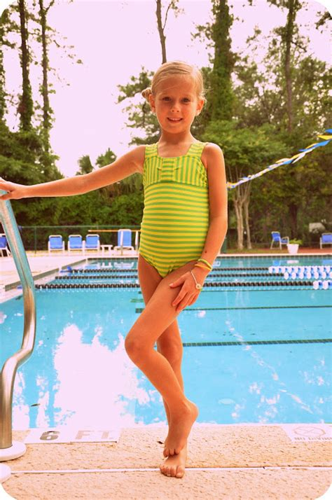 girl 8 yrs and boy 5 yrs swimming underwater in a pool part 2 of no big dill a big splash swimsuit tutorial