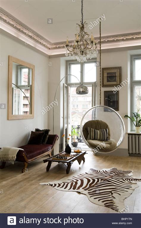 zebra rug in living room eero aarnio chair in living room with zebra skin rug and stock photo royalty free image