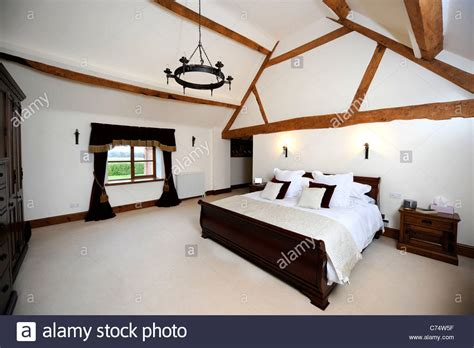 vaulted ceiling bedroom master bedroom with a vaulted ceiling in a converted barn