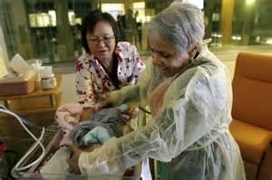 hospital volunteer meet the strangers who cuddle sick newborn babies to help