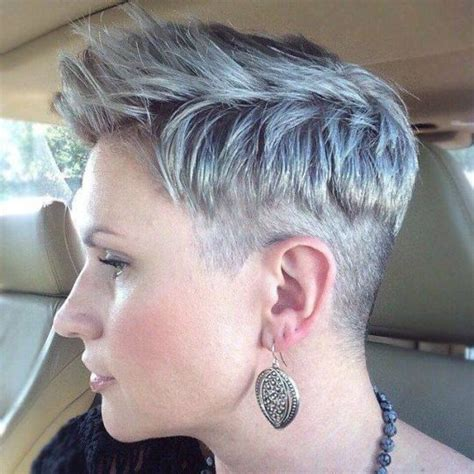 woman cuts hair with fork and clippers pixie cut with a clipper cut edge sides and nape buzzed