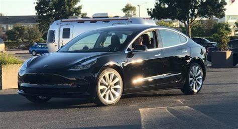 Production Tesla Model 3 photo of tesla model 3 production car musk gifted