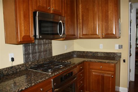kitchen range with metal backsplash kitchentoday