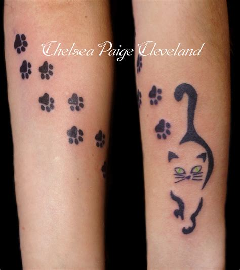cat tattoo with paw prints cat and paw prints tattoo by chelsea cleveland by