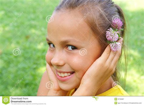 anoword tiny model preteen girl with clover flower royalty free stock