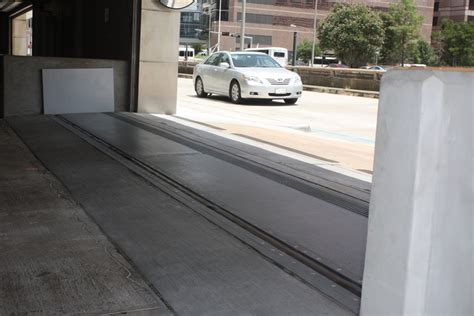 Parking Garage Protection by Automatic Flood Protection For Garage Entrances