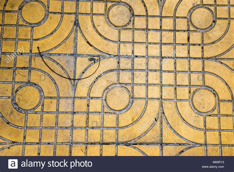 yellow patterned ground paving stone road closeup green stock photos paving