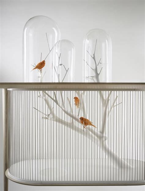 cage archibird a modern bird cage doubles as a table