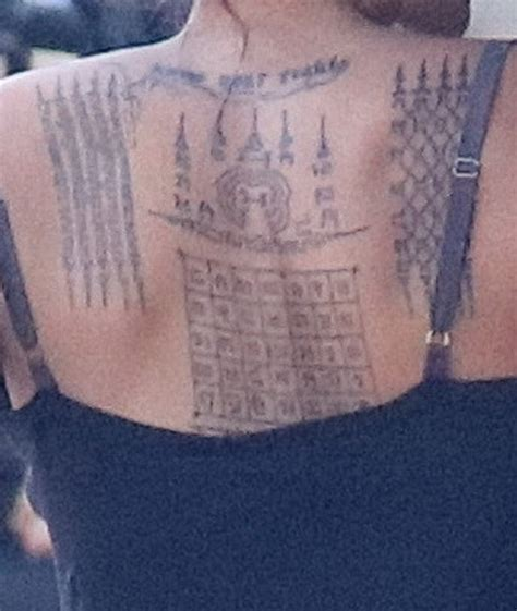 angelina jolie new tattoo got three new tattoos on back and