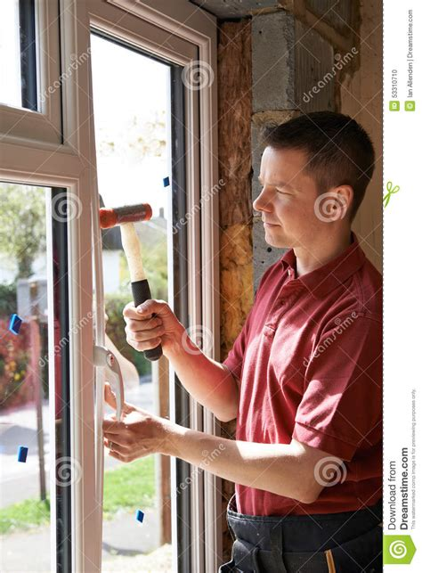 installing windows in house construction worker installing new windows in house stock photo image 53310710