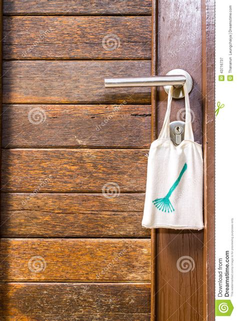 clean room sign hang on door knob stock photo