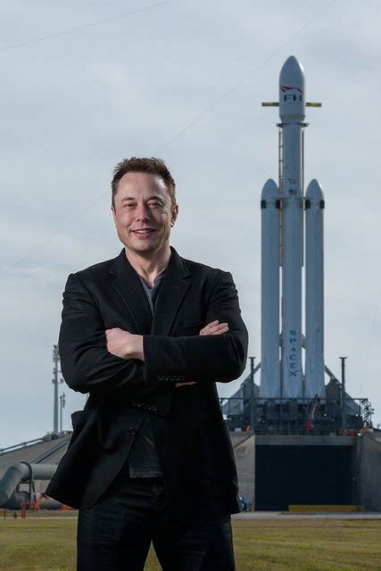 elon musk spacex falcon heavy in a roar of thunder carries spacex s