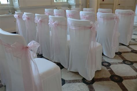 dusky pink organza sashes on white chair covers with side