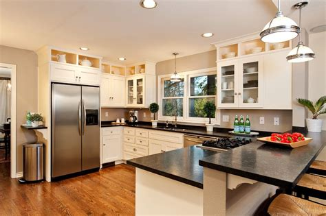 stove in peninsula kitchen traditional with wood floors