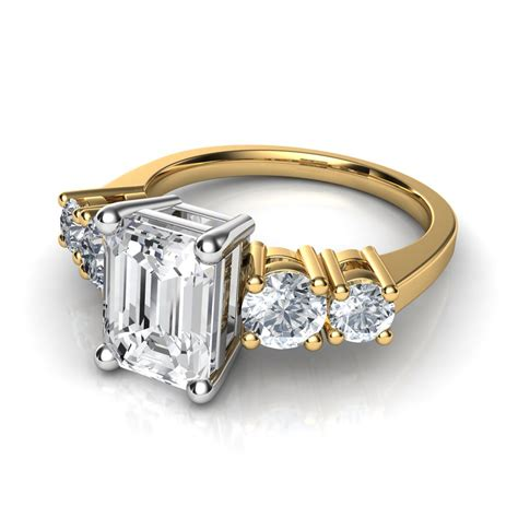 and emerald cut engagement ring