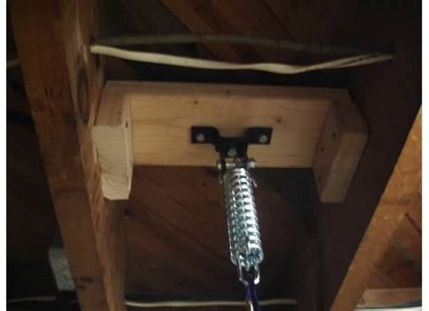 how to hang a punching bag from the ceiling hanging heavy bag in the basement rosstraining