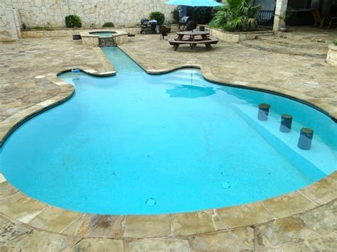 guitar shaped swimming pool 8 pools in a variety of peculiar shapes realtor 174