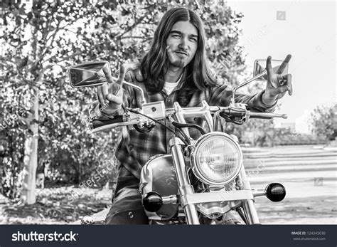 long hairstyles for a biker man young long hair male hippie motorcycle stock photo