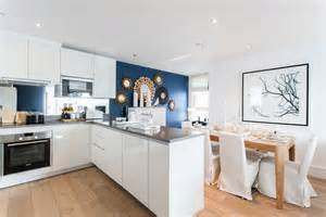 Blue accent wall kitchen contemporary with wall art white counter