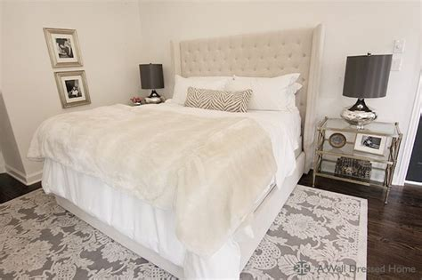 stunning bedroom with beige tufted headboard accented with