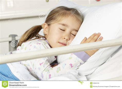 girl in hospital bed young girl asleep in hospital bed stock photo image