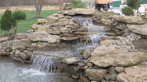 how to build a pool waterfall beaux mondes designs guest post home landscaping why