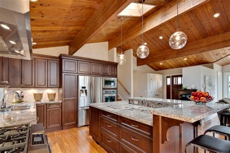 open concept kitchen  vaulted wood ceiling