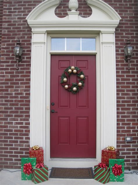 red door home decor designed to dwell the front porch at christmas