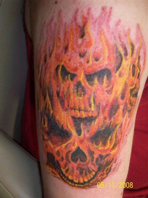skull with flames tattoo designs flaming skull on half sleeve