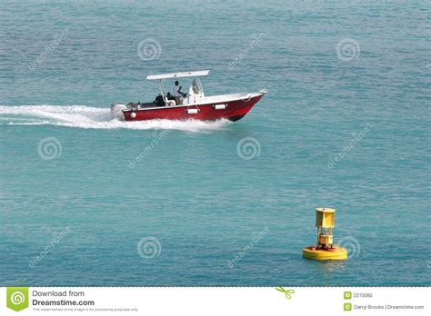 boat on buoy red boat yellow buoy stock photo image of bouy ocean