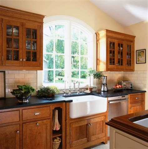 Farmhouse Style Kitchen Cabinets Maple Wooden Cabinet With White Ceramic Sink And Black Counter Using Decorative Faucets For