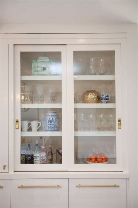 A Kitchen Makeover Modern Fresh And White Sliding Kitchen Cabinet Door Makeover