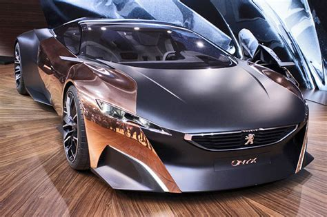 peugeot onyx oxidized peugeot s onyx hybrid supercar may be the belle of the