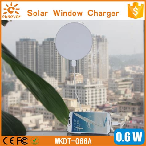 solar powered phone charger sticks to window car window stick square solar powered phone charger view