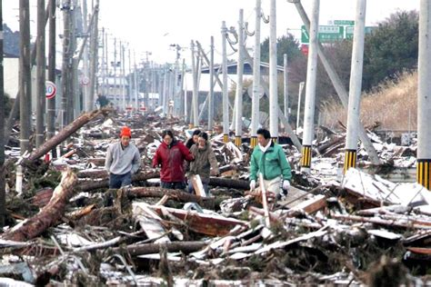 Delayed Green Light by People Walk Through Tsunami Destruction Abc News