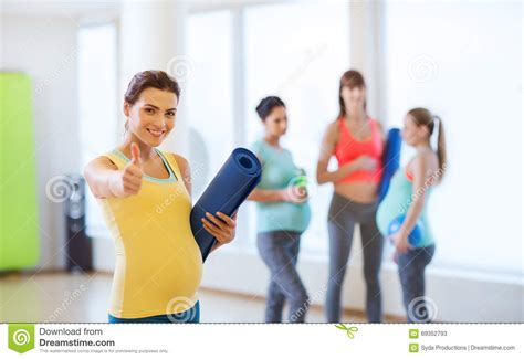 Pregnancy Mat by With Mat In Showing Thumbs Up Stock