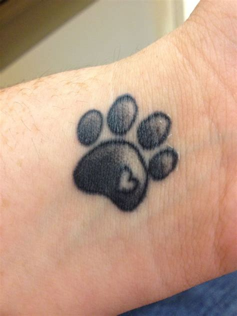 small dog paw print tattoo 1000 ideas about cat paw tattoos on paw