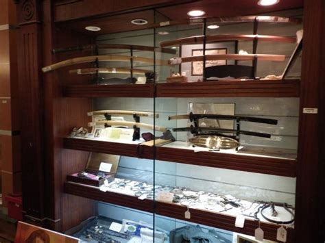 swords lots of pictures inside some swords inside pawnstars shop picture of gold and