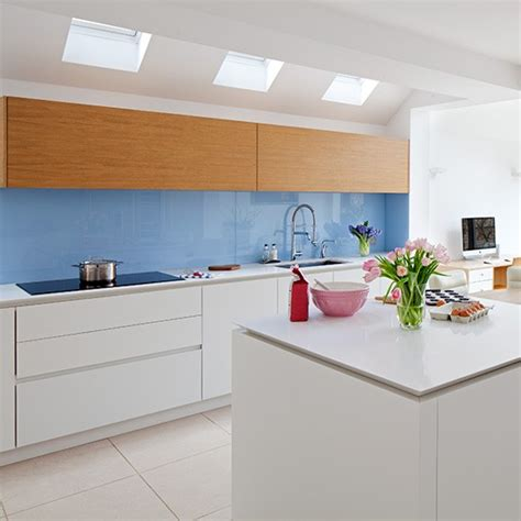 white modern kitchen with blue glass splashback design