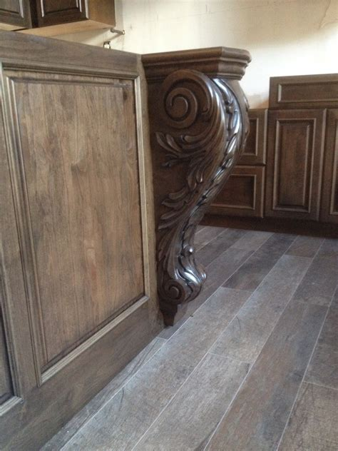 custom cabinetry in ny kitchen features tuscan corbels