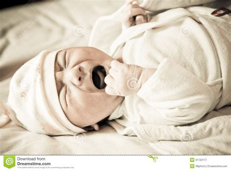 crying in bed newborn baby crying on the bed royalty free stock