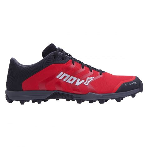 running shoe fitting the inov8 x talon 225 in black and grey precision fit