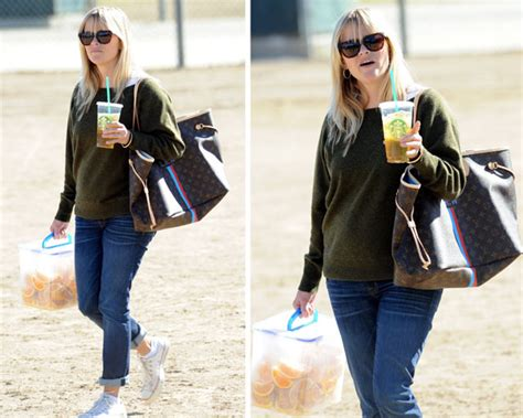 Norton To Name Purse After Reese Witherspoon by Reese Witherspoon Carries Orange Wedges And Louis Vuitton