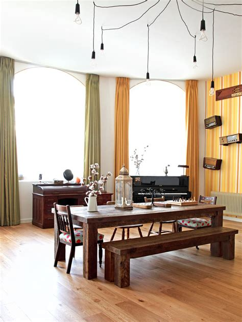 eclectic dining room with window seat hardwood floors rustic wood dining table dining room traditional with