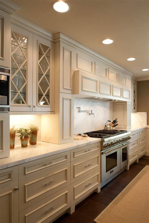 beige cabinets kitchen contemporary  recessed lights